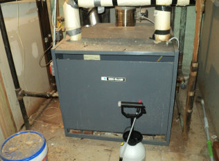 Here is a large Weil McLain gas steam boiler in an apartment building and dental office business in Passaic, NJ